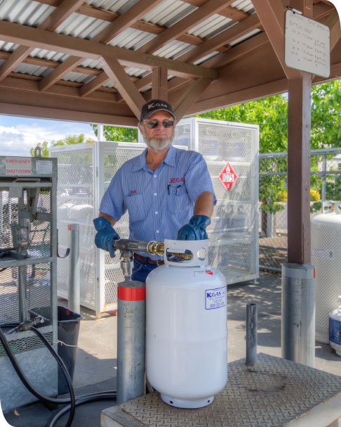 Long time employee refilling a propane tank